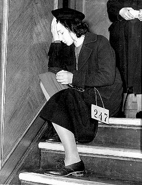 Jewish refugee girl from Vienna, Austria, upon arrival in Harwich. Great Britain, December 12, 1938.
