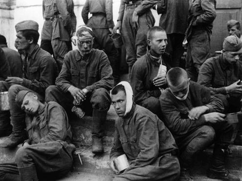Wounded Soviet prisoners of war. The German army provided only minimal treatment, and permitted captured Soviet personnel to care for their own wounded using only captured medical supplies. Baranovichi, Poland, wartime.