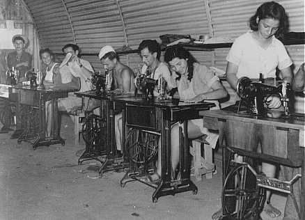Jewish refugee youths, prevented by the British from landing in Palestine, learn sewing at a detention camp. The machines are provided by the American Jewish Joint Distribution Committee (JDC). Cyprus, 1947.