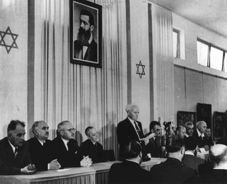 Prime Minister David Ben-Gurion reads the declaration of the state of Israel at an official ceremony following the United Nations' partition of Palestine. Tel Aviv, May 14, 1948.