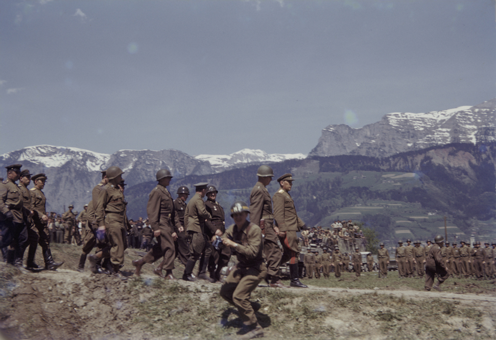 Members of the US 9th Armored Division meet up with Soviet units near Linz, Austria. This photograph was taken by Signal Corps photographer Arnold E. Samuelson. Austria, May 2, 1945.
