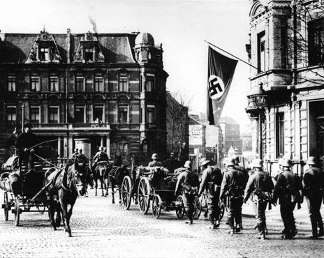 German forces enter Aachen, on the border with Belgium, following the remilitarization of the Rhineland. Aachen, Germany, March 18, 1936.