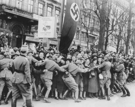 Cheering crowds greet Hitler as he enters Vienna. Austria, March 1938.