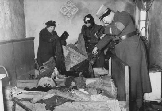 German police raid a vandalized Jewish home in the Lodz ghetto. Lodz, Poland, ca. 1942.
