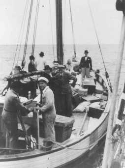 Danish fishermen (foreground) ferry Jews across a narrow sound to safety in neutral Sweden during the German occupation of Denmark. Sweden, 1943.