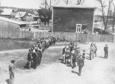 Employees of the Jewish council in the Kovno ghetto assemble during roll call, which was taken on a daily basis. Kovno, Lithuania, between 1941 and 1943.