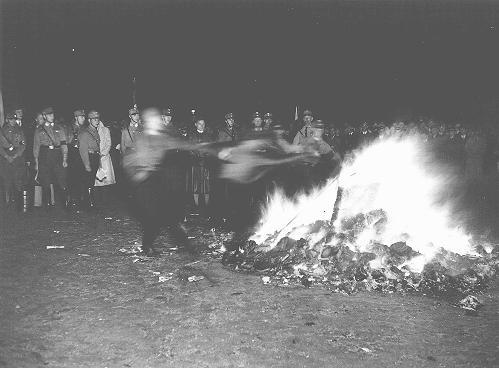 "In Hamburg, members of the SA and students from the University of Hamburg burn books they regard as ""un-German."" Hamburg, Germany, May 15, 1933."