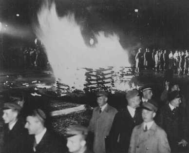 "Public burning of ""un-German"" books in the Opernplatz. Students, some in SA uniform, march in a torchlight procession. Berlin, May 10, 1933."