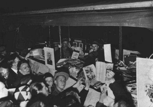 "German students gather around books they regard as ""un-German."" The books will be publically burned at Berlin's Opernplatz. Berlin, Germany, May 10, 1933."