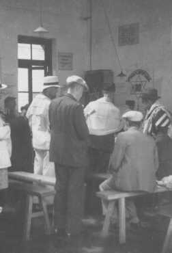 Jewish refugees at prayer in a synagogue. Shanghai, China, date uncertain.