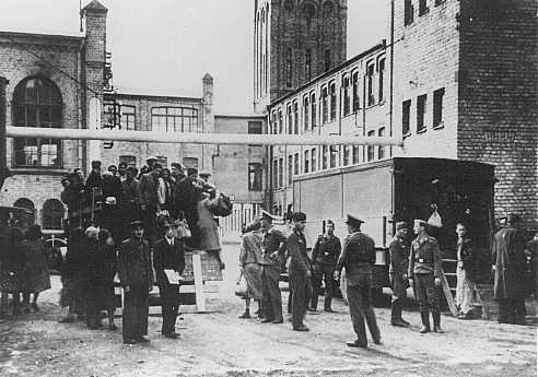 Jews from the Riga ghetto arrive at their forced-labor assignment in the Luftwaffe (German air force) field clothing depot. Riga, Latvia, 1942.