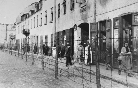 View of a barbed-wire fence separating part of the ghetto in Krakow from the rest of the city. Krakow, Poland, date uncertain.