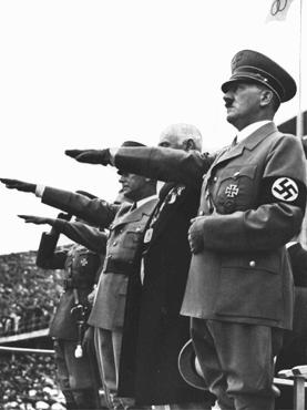 Adolf Hitler salutes the Olympic flag at the opening of the Olympic Games in Berlin. Germany, August 1, 1936.