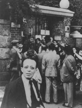 Hungarian Jews wait in front of the Swedish legation main office in hopes of obtaining Swedish protective passes. Budapest, Hungary, 1944.