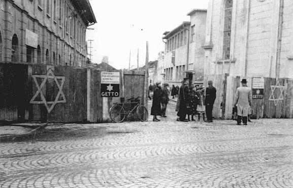 Guards check the identification papers of women entering the ghetto in Munkacs, in a part of Czechoslovakia annexed by Hungary in 1938. Czechoslovakia, 1944.