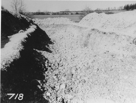 View of a mass grave in the Ohrdruf concentration camp from which 2,000 corpses were removed for proper burial. Ohrdruf, Germany, between April 20 and 25, 1945.