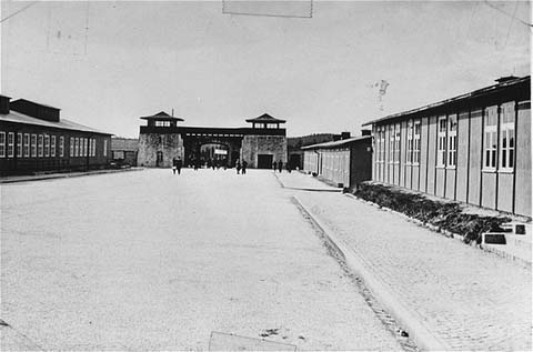 The roll call square in the Mauthausen concentration camp, looking toward the main gate. This photograph was taken after the liberation of the camp. Mauthausen, Austria, between May and September, 1945.