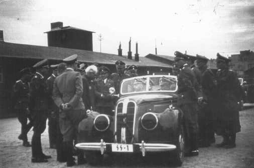 Mordechai Chaim Rumkowski (with white hair) and SS chief Heinrich Himmler on Himmler's first visit to the Lodz ghetto. Lodz, Poland, June 5, 1941.