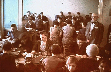 Jewish women at forced labor in a sewing workshop. Lodz ghetto, Poland, between 1940 and 1944.