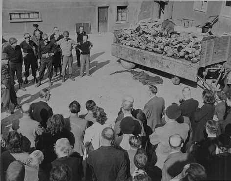 German civilians under US military escort are forced to view a wagon piled with corpses in the newly liberated Buchenwald concentration camp. Buchenwald, Germany, April 16, 1945.