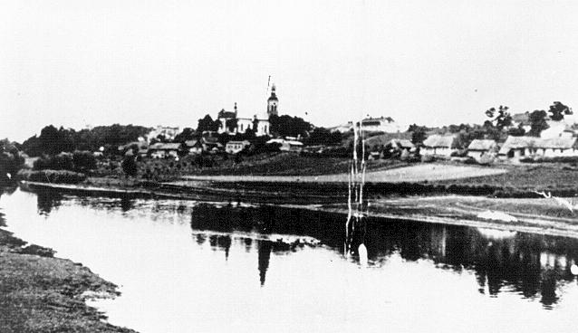 View of the village of Chelmno. To the left of the church is the Schloss, one of two sites of the Chelmno camp. The Schloss, an old country estate, served as a reception and extermination center for victims until it was demolished in April 1943. Chelmno, Poland, 1939–1943.
