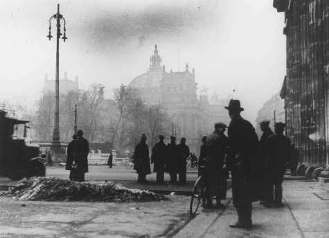 Onlookers in front of the Reichstag (German parliament) building after its virtual destruction by fire. Berlin, Germany, February 28, 1933.