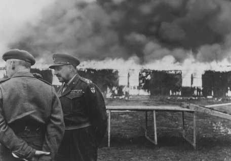 The Bergen-Belsen former concentration camp is burned to the ground by British soldiers to prevent the spread of typhus. Germany, May 21, 1945.