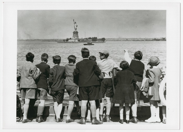 Children aboard the President Harding look at the Statue of Liberty as they pull into New York harbor. They were brought to the United States by Gilbert and Eleanor Kraus. June 1939.