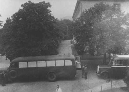 Buses used to transport patients to Hadamar euthanasia center. The windows were painted to prevent people from seeing those inside. Germany, between May and September 1941.