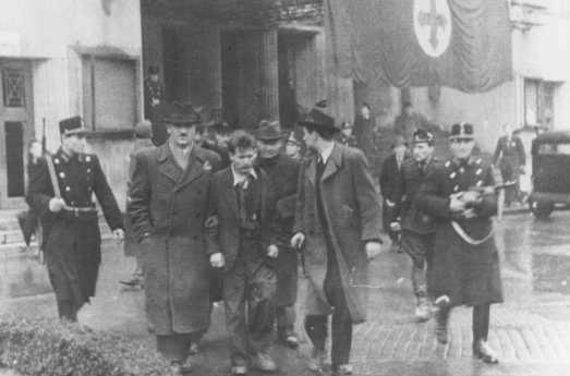 Members of the fascist Arrow Cross Party arrest Jews. Budapest, Hungary, October-December 1944.
