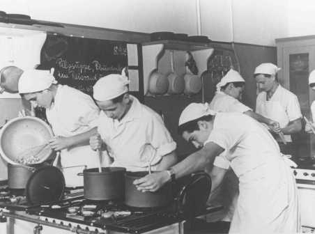 Pre-emigration training: young Jews in a cooking class in the Theodor Herzl School sponsored by the Jewish community. Berlin, Germany, between 1930 and 1939.