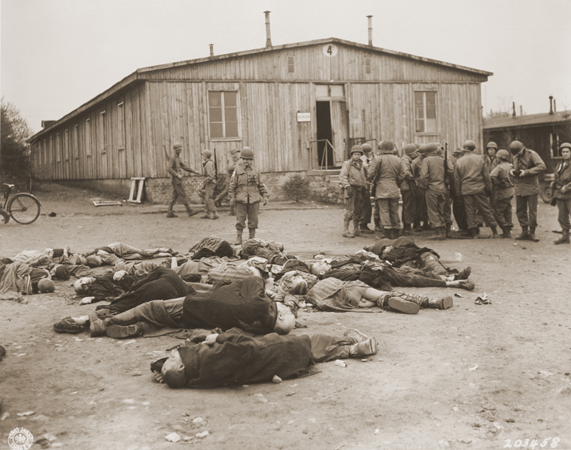 American soldiers view the bodies of prisoners found in the newly liberated Ohrdruf concentration camp. Ohrdruf, Germany, April 6, 1945.