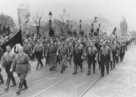 Adolf Hitler, Julius Streicher (foreground, right), and Hermann Goering (left of Hitler) retrace the steps of the 1923 Beer Hall Putsch (coup). Munich, Germany, November 9, 1934.
