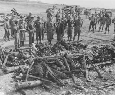 General Dwight D. Eisenhower (third from left) views the charred remains of inmates of the Ohrdruf camp. Ohrdruf, Germany, April 12, 1945.