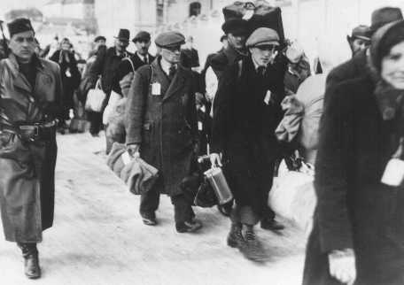 Deportation of Slovak Jews. The victims wear tags and are escorted by Slovak guards. Czechoslovakia, ca. 1942.