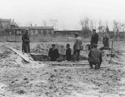 Prisoners at forced labor under SS and police guard in the Oranienburg concentration camp. Oranienburg, Germany, 1934.