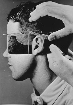 Establishing racial descent by measuring an ear at the Kaiser Wilhelm Institute for Anthropology. Germany, date uncertain.