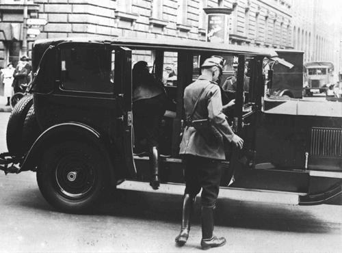 After Hitler became chancellor of Germany, he persuaded his cabinet to declare a state of emergency and end many individual freedoms. Here, police search a vehicle for arms. Berlin, Germany, February 27, 1933.