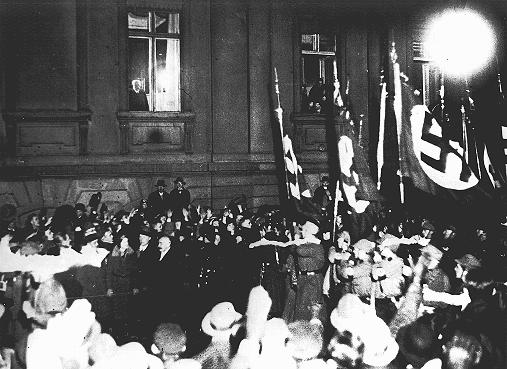 From a window in the Reich Chancellery, German president Paul von Hindenburg watches a Nazi torchlight parade in honor of Hitler's appointment as German Chancellor. Berlin, Germany, January 30, 1933.