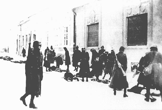 Hungarian soldiers and gendarmes participate in the mass killing of Serbian Jews and Serbians. Novi Sad, Yugoslavia, January 23, 1942.