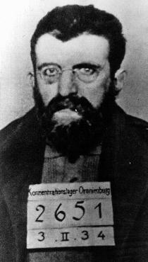 Identification picture of Erich Muehsam taken in the Oranienburg concentration camp. Muehsam, an anarchist and a pacifist, worked as an editor and writer; he was imprisoned during World War I for opposing the war.  Arrested during the massive roundup of Nazi political opponents following the Reichstag fire (February 27, 1933), Muehsam was tortured to death in Oranienburg on July 11, 1934. Oranienburg, Germany, February 3, 1934.
