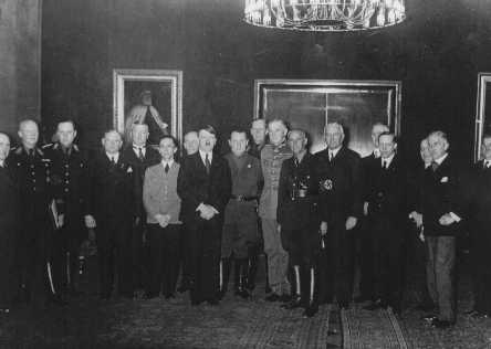 Adolf Hitler poses with his cabinet shortly after assuming power as chancellor of Germany. Hitler is flanked by Joseph Goebbels (left) and Hermann Goering (right).  Berlin, Germany, 1933.