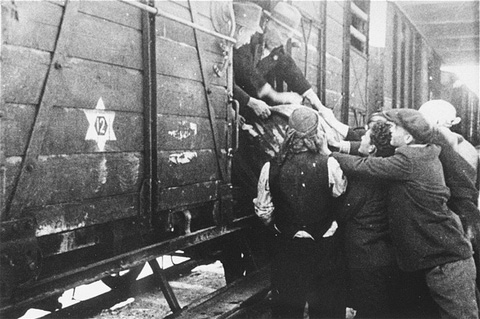 Jews load a barrel of water onto a deportation train in Skopje. In March 1943, Jews of  Macedonia were rounded up and assembled at the Tobacco Monopoly in Skopje, where several building had been converted into a transit camp. They were deported by train to Treblinka. Skopje, Yugoslavia, March 1943.