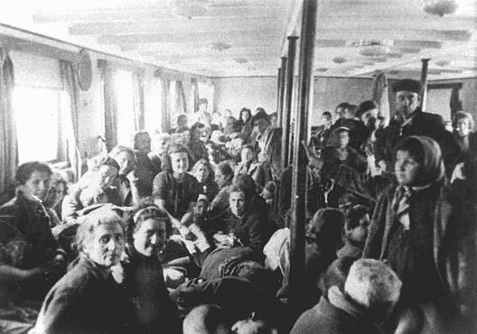 Thracian Jews crowded into an interior room of a deportation ship just before it left the port of Lom. Lom, Bulgaria, March 1943.