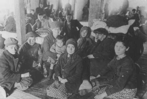 Jews from Macedonia who were rounded up and assembled in the Tobacco Monopoly transit camp before deportation to the Treblinka killing center. Skopje, Yugoslavia, March 1943.
