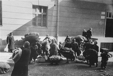 Macedonian Jews leave the Tobacco Monopoly transit camp in Skopje for the deportation trains. Skopje, Yugoslavia, March 1943.