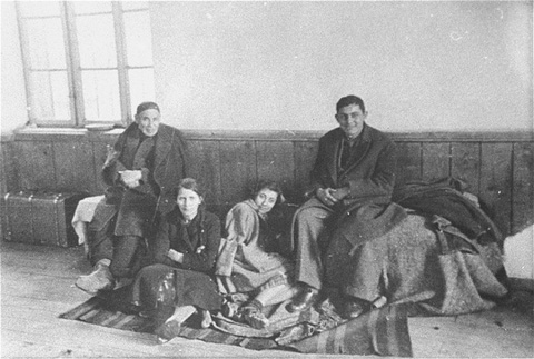 At the Tobacco Monopoly transit camp in Skopje, a family of Macedonian Jews awaits deportation. Skopje, Yugoslavia, March 1943.