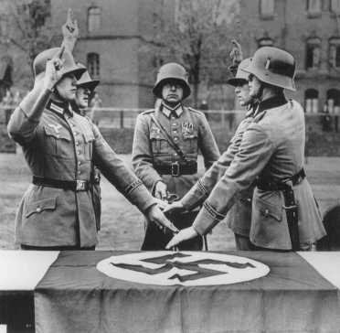 Members of a military unit swear allegiance to Hitler. Germany, date uncertain.