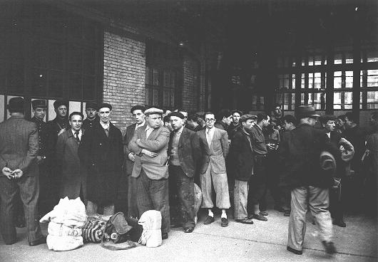 After the first roundup in Paris, French police escort foreign Jewish men from the Japy school to deportation trains at the Austerlitz station. Paris, France, May 14, 1941.