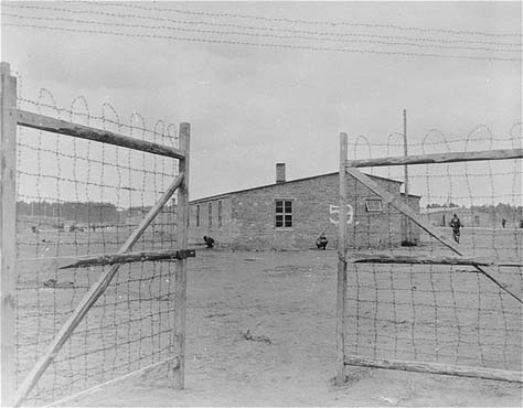 The main gate of the Wöbbelin concentration camp. On May 2, 1945, the 8th Infantry Division and the 82nd Airborne Division encountered the Wöbbelin concentration camp. Photograph taken upon the liberation of the camp by US forces. Germany, May 4, 1945.